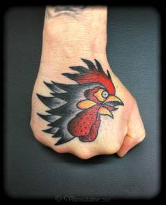 Rooster-head-on-hand-vittoriatattoo-tattoos-by-vittoria
