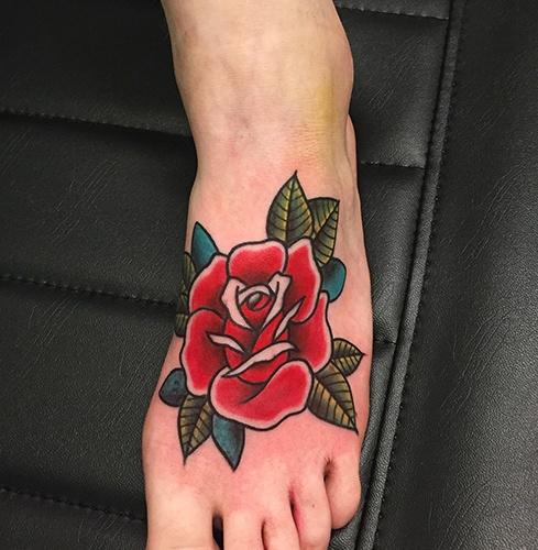 Oldschool-red-rose-on-foot-tattoo