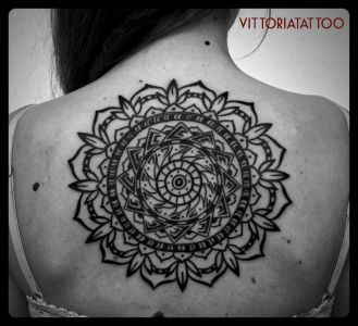 black and white tattoo mandala on back
