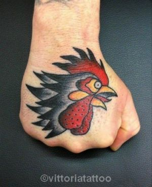 tattoo rooster-head-on-hand
