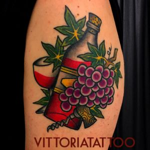 traditional wine bottle and grappe tattoo