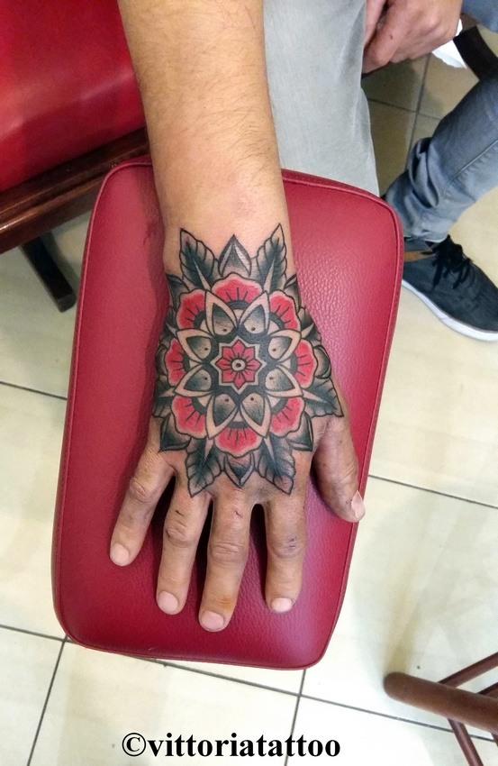 old school flower hand tattoo-vittoriatattoo