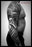 Polynesian Style Arm tattoo
